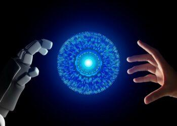 masa depan ai, teknologi digital, wa web, ib bri, bisnis ai - human hand and robot hand with hud circle interface and binary number code on black screen background t20 AVANJV 350x250 - AI : Apa Itu Teknologi Artificial Intelligence