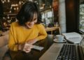 paket internet unlimited convert youtube jadi mp3 - young hipster woman smiling sitting in coffee shop using smartphone smiling technology happy internet t20 XznLE6 120x86 - Cara Convert Youtube Jadi Mp3